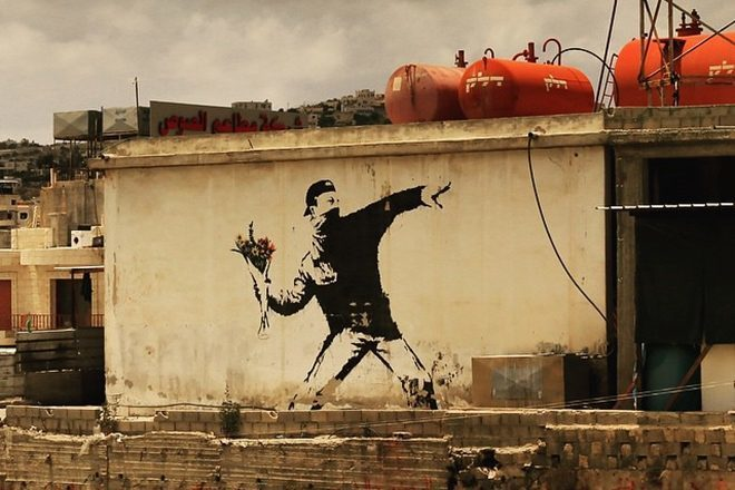 Banksy loses copyright to west bank artwork after refusing to reveal identity